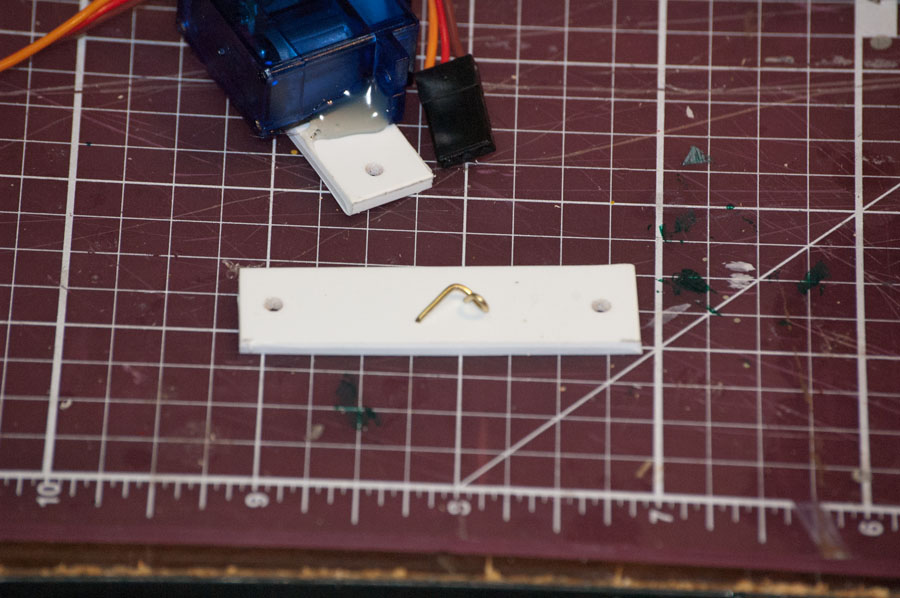 These two parts allow you to side mount a micro servo, and connect its horn to a rod.